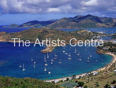 View over the moored boats anchored in English and Falmouth Harbours from Shirley Heights on Antigua Caribbean