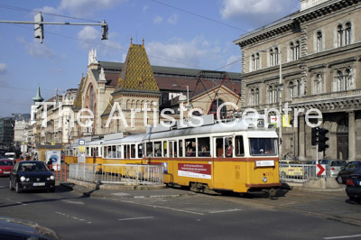 Tram passing Central Market in Budapest