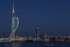 Night view of Spinnaker Tower and historical Portsmouth harbour Hampshire England