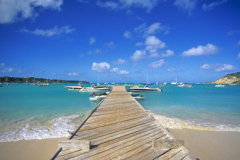 Sea,  beach and wooden jetty at Road Bay Anguilla Caribbean