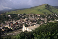 Landscape scene of town and hills in Dominca