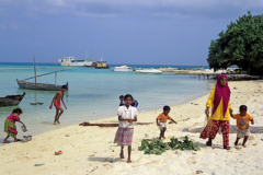 Local children playing on beach Maldives Indian Ocean