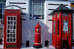 Old red telephone boxes and post box in New Zealand