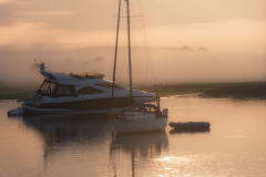Misty morning peaceful setting of boats moored